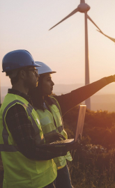 Electrical engineers on a field of wind turbines