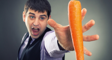 Man aiming for a carrot