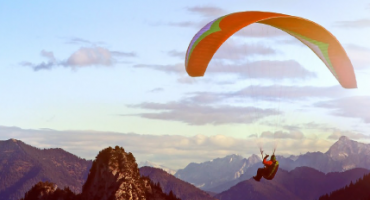 man gliding on parachute