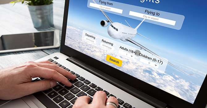 Booking flight on laptop
