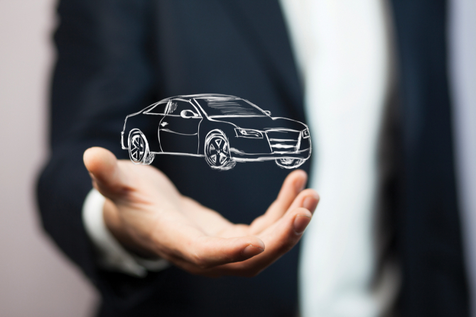 Man holding hologramic drawing of a car