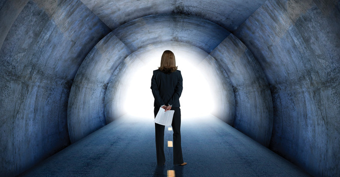 Businesswoman standing in a tunnel