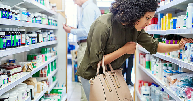 woman looking for product in supermarket