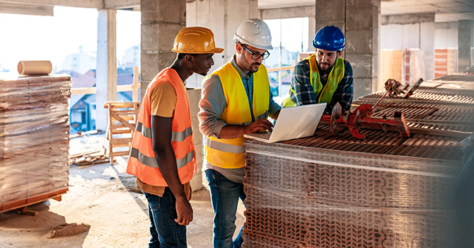 three man on building site
